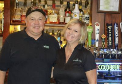 Bill Greer and Stacy Mercer stand in front of their taps at LT Corner Pub in Lakeway.