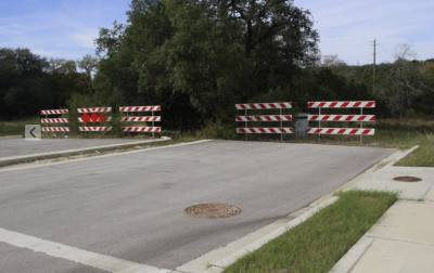 Barriers block what is expected to be a four-lane extension of Lakeway's Main St. into what are known as the Stratus and MUD tracts.