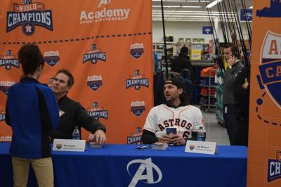 Steve Sparks, a commentator for the Astros, and Marisnick talk with fans at the autograph booth.