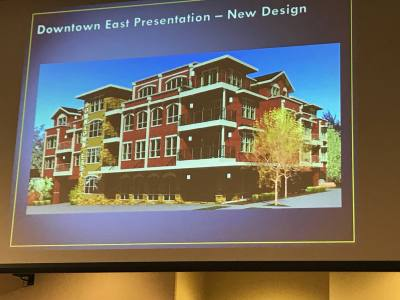 City staff displayed an updated design concept Tuesday, Jan. 9, for the proposed development at 204 E. Eighth St., which was denied a certificate of appropriateness.