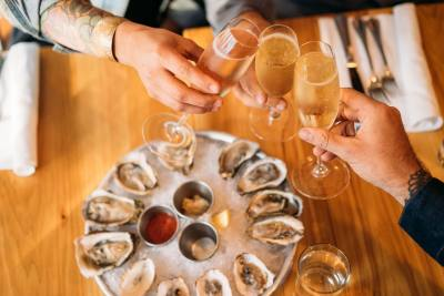 To celebrate its 10th anniversary, Parkside is offering 10 days of half-off oysters and champagne.