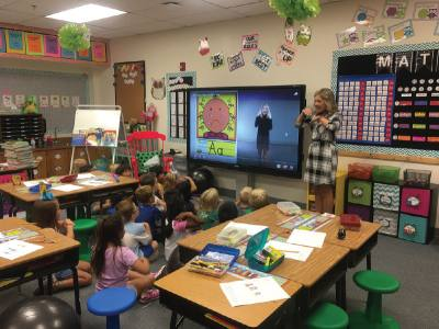 Bailey Buck, a teacher at Johnson Elementary School, uses the presentation station planned for teacher classrooms.