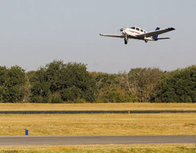 A plane takes off from the Georgetown Municipal Airport, which is expected to update its master plan in 2018.