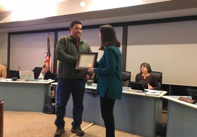 Josh McKay was presented a plaque by Mayor Roxanne McKee at the Rollingwood City Council meeting on Jan. 17.