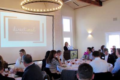 Laura Mitchell, president of the Lake Travis Chamber of Commerce, introduces guests at the 2018 Lake Travis Economic Forecast on Jan. 17.