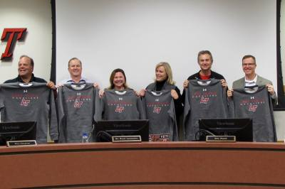 From left: Lake Travis ISD trustees Bob Dorsett Jr., John Aoueille, Kim Flasch, Lisa Johnson, Alex Alexander and William Beard pose Jan. 23 with shirts received for School Board Recognition Month.