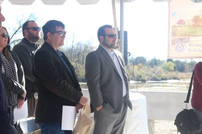 Hays County Precinct 2 Commissioner Mark Jones (left) stands next to Will Conley at a ribbon cutting in December. Jones will serve as Hays County's Capital Area Metropolitan Planning Organization representative.