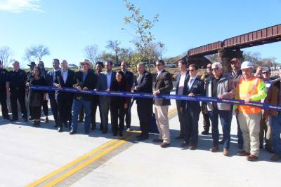 Officials cut the ribbon for the opening of Post Road Bridge, which was completed in December.