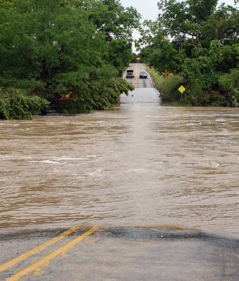 Flooding like the one pictured here, at the Onion Creek double crossing of RM 150 in Hays County, have become familiar along Flash Flood Alley.