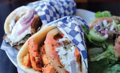 Gyros, offered with lamb or chicken come with a side salad and tzatziki sauce.