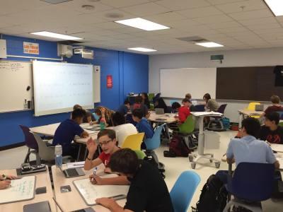Westlake High School students work in a classroom utilizing flexible furniture.