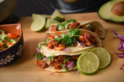 In the Cochinita pibil taco ($3.99) shredded pulled pork in salsa achioteis served with purple onion, choppedncilantro and a lime wedge.