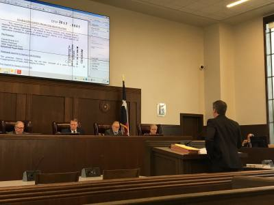 Joseph Stallone, an attorney representing the owner of Float Fest, addresses Guadalupe County commissioners during a festival permit public hearing on Feb. 27.