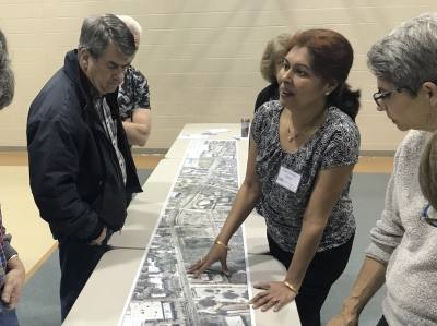 One of the engineers on the Anderson Mill Road Regional Mobility Project, Dipti Borkar-Desai, explains the project's features to local residents.