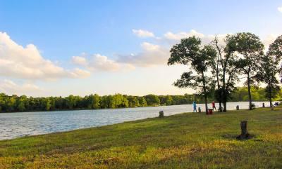 Visitors to Lake Lakewood fish in the lake at site of the city of Leanderu2019s future Lakewood Park last June.
