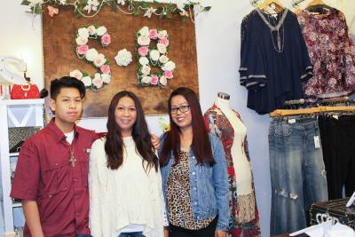 Rum Kep (center) and her sister Sona Chin (right) relocated Sunnyu2019s Boutique from Spring to Shenandoah in June.