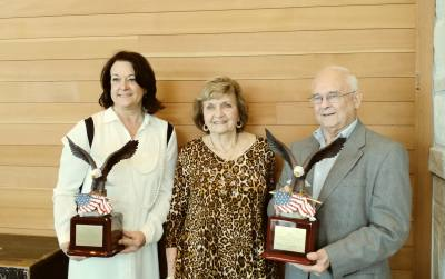 Cathy Zerwas (left), Patsy Stanley (center) and Bill Callegari pose for a photo after the awards presentation.  Zerwas accepted the award on her husband's behalf because he was traveling.