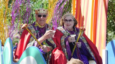 2017 Mistick Krewe of Okeanos king and queen sits upon their royal float.
