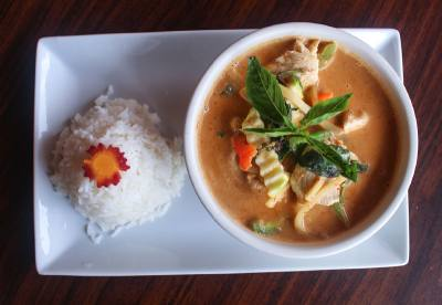 Red curry with zucchini, bamboo shoots, bell peppers and fresh basil.