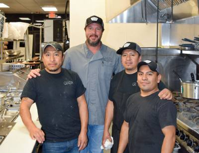 Hembree (second from left) and chef Juan Garcia (left) pose with their kitchen staff ahead of the April 19 soft opening.