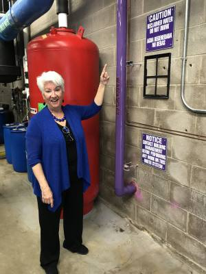 Commissioner Brigid Shea, pictured here in May 2018, helped spearhead the reclaimed water system, or purple pipe, for the county.
