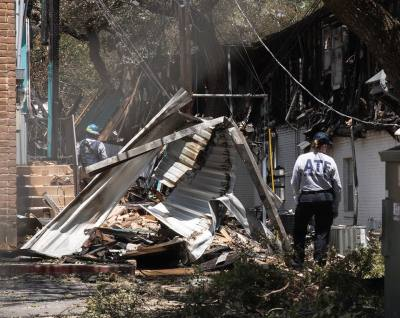 Agents from the Bureau of Alcohol, Tobacco, Firearms and Explosives investigate the San Marcos apartment complex fire on Saturday afternoon.
