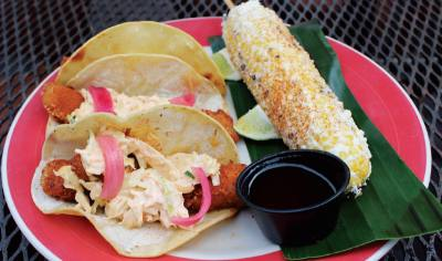 The Tacos Pacifico ($14 for three) feature fresh Costa Rican tilapia and a side of street corn on the cob.