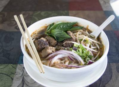 Guay Tiew, $9, is a Thai noodle soup with rice noodles, bean sprouts, red onions, and cilantro in beef broth with an option of stewed beef or steamed chicken.