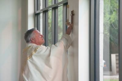 Father Norbert Maduzia of St. Ignatius of Loyola Catholic Church prepared the church for its rededication in May after renovating in the wake of property damage caused by Hurricane Harvey.