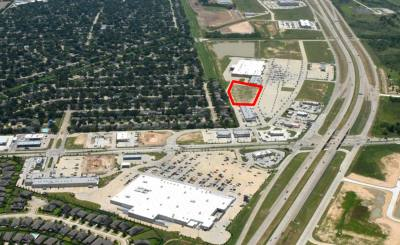 From bottom to top: Wal-Mart is located on the north side of Morton Ranch Road at the Grand Parkway. The new building will be constructed at the area outlined in red, just north of the Kroger store, which opened in 2016.