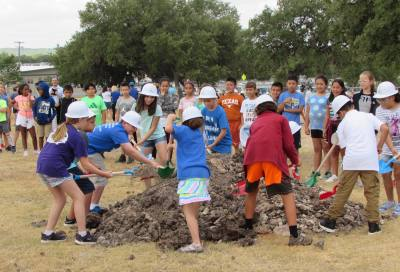 Students break ground at Menchaca Elementary School Aug. 30, 2018.