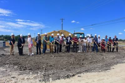 Officials from Journeyman Group, Civitias and the city of Kyle take part in the groundbreaking ceremony for The Philomena.