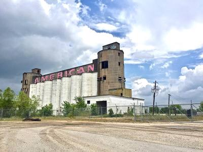 The old silos located off of Rice Drier Road in east Pearland will be demolished as a developer makes way for a new commercial park.