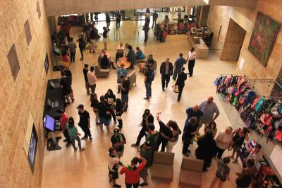 Members of the public fill the lobby of Austin City Hall ahead of Austin City Council's meeting on Thursday, August 9.