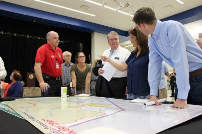 Congressman John Culberson R-Houston and Harris County Emergency Services District 48 Public Information Officer Simon Van Dyk speak with residents about the proposed projects for the Barker Reservoir watershed.
