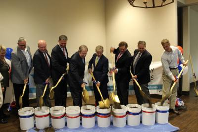 Officials with the I-635/SH 121 interchange project turn shovels for the groundbreaking.