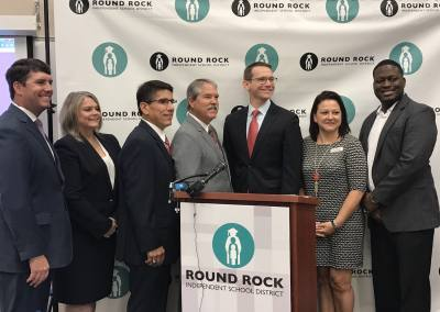 (From left) Trustee Mason Moses, Board of Trustees President Diane Cox, Superintendent Steve Flores, Sen. Larry Taylor, Commissioner Mike Morath, Trustee Nikki Gonzales and Trustee Edward Hanna gather to announce Round Rock ISD's accountability rating.