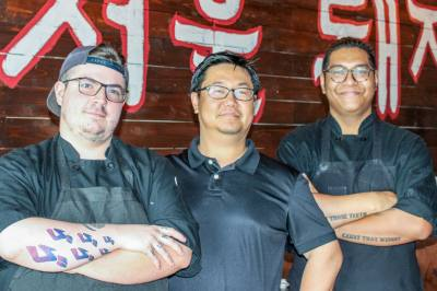Owner Danny Kim (center) is flanked by his cooks, Kevin Simmons (left) and James Romero. Kim opened Seoul Pig a year ago when he recognized an opportunity for Korean barbecue in Pearland.