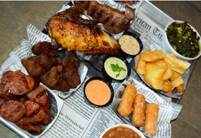 The Roko Sampler lets diners try a little bit of everything, including smoked sirloin, sweet and spicy sausages, fried pork, a quarter chicken and three sides. A variety of dips are also offered.