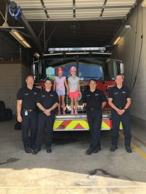 Isabella Spapperi-Winters and Ella Hallett (third grade) took an u201con-the-go snacksu201d gift basket with thank you cards to the local fire department. On the same day the girls also visited the police department to deliver cookies and thank you notes.
