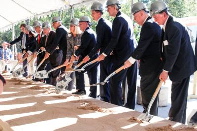 Sam Houston State University broke ground on its proposed College of Osteopathic Medicine Nov. 16. SHSU administrators like SHSU President Dana Hoyt (center), along with local government officials, posed for a photo.