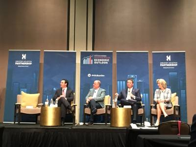 Tony Canales, president and general manager of Telemundo Houston; Mike Potter, chief technology officer of Hewlett Packard Enterprise; Troy Villarreal, president of HCA Gulf Coast Division; and Cindy Taylor, president and CEO of Oil States International, speak at the GHP Economic Outlook Forum Dec. 5.