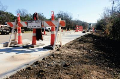 City construction of new sidewalks and a shared-use path on Adelphi Lane in Northwest Austin is from December 2018.