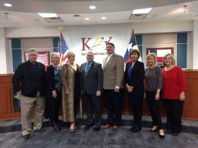 Ken Gregorski (fourth from left) stands with Katy ISD board members after they voted 7-0 on Jan. 14 to approve his contract as superintendent.