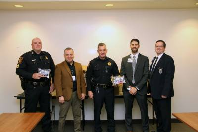 From left, Precinct 5 Sgt. James Preston, Houston Methodist West Security Services Manager  Paul Martinez, Chief Jordan Goff, Houston Methodist West Director of Operations Zach Weyand and Charles Ellis stand with the donated tactical first aid kits.