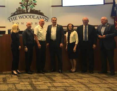 The Woodlands Township Fire Department Chief Alan Benson, third from left, announced his retirement April 24 at the board of directors meeting.