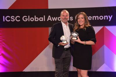 Phillip St. Pierre, general manager of Hill Country Galleria and Courtney Bunte, property marketing manager, are seen with the awards.