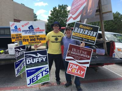 Cedar Park Firefighter Austin Payne and Lyle Grimes, a former Cedar Park City Council member, support candidates on election day.