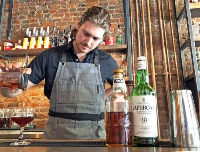 Bar manager Kevin Dubinski crafts traditional cocktails,u00a0nsuch as Manhattans, nsazeracs, mint juleps nand Negronis.
