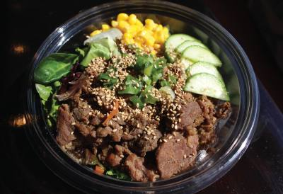 Customers can choose a base, proteins, spice level and toppings to customize a bowl.